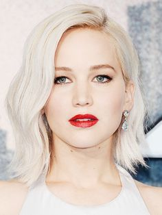 Jennifer Lawrence's bob haircut is a great way to disguise a bigger forehead. If you think your head looks long, then you need to create width in your hair.