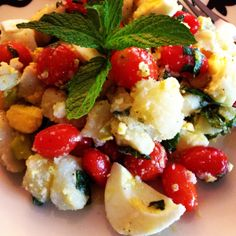 boiled eggs, baked potatoes, cherry tomatoes, pepperocini, mint leaves, salt, black, pepper, olive oil, vinegar