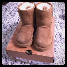 UGG toddler size 6 Worn, still in good condition size 6 in toddler UGG Shoes Winter & Rain Boots