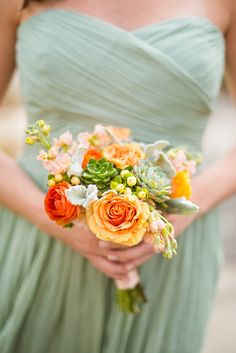 Sage green bridesmaid dresses with contrasting orange #bouquet. Photography: Stephanie Dee Photography - www.stephaniedeeblog.com Read More: http://www.stylemepretty.com/2014/07/15/elegant-virginia-wedding-at-the-atrium-at-meadowlark-botanical-gardens/