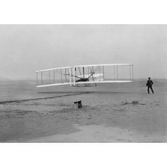 The first flight of the Wright Flyer in 1903 Canvas Art - John ParrotStocktrek Images (17 x 12)