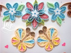 Lin has some really good paper quilling tutorials