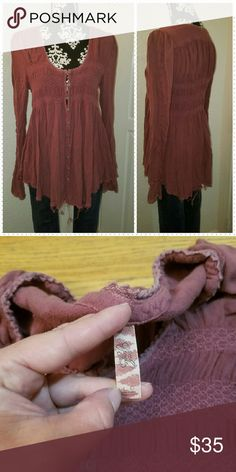 Free people flowy long sleeve tunic Women's size large long sleeve flowy tunic by free people in great condition ' color most accurate to last 2 pictures Free People Tops Tunics
