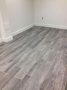 Basement Tile Floor Ideas Gray Wood Tile Floor Basement Flooring Ideas Wood Tile - Decornish [dot] com Grey Wood Tile, Grey Floor Tiles, Wood Tile Floors, Grey Flooring, Flooring Ideas, Gray Floor, Gray Hardwood Floors, Wood Look Tile Floor, Wood Grain Tile