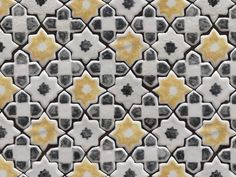 Handmade and painted ceramic tiles, arabesque pattern in black, white and yellow