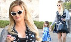 Holly Madison takes daughter stroll after giving birth to second child