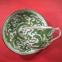 Early 1800s English Porcelain Green Dragon Teacup and Saucer with enameling and gilding