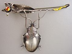 Brooch | Peggy Johnson. 'Beetle with flower'  Sterling silver, touches of gold on stem end, citrine stone
