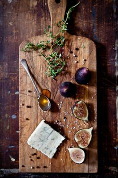 gorgeous bread board with figs, thyme, and cheese, yummy! This is food art!
