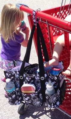 The hang it up key FOB... Cheaper than a mommy hook! $5. And prettier too!! Organizing utility tote ($30) (item# 3105) works great as a diaper bag.