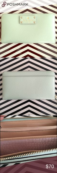 Kate Spade Mint Green Wellesley Wallet NWT Mint green with a light pink interior. 7x3 inches. 1 1/2 inch Kate Spade name plate. 12 card compartments. kate spade Bags Wallets