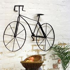 Add some urban flair to your outdoor space with this Metal Bicycle Wall Art.