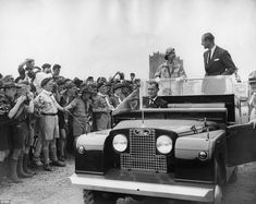 Queen Elizabeth II riding in a Land Rover with Prince Philip, through the World Scout Jubilee Jamboree camp in Sutton Park, Warwickshire