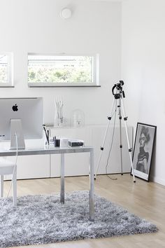 Lovely white workspace. Don't like the carpet as it might create fluff but otherwise it is brilliant.