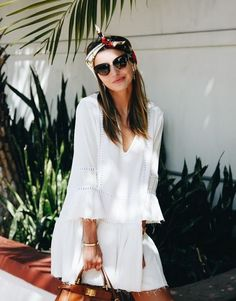 Forget the LBD, when temperatures soar it's the little white dress we reach for. The perennial summer favourite can be thrown on for myriad occasions – summer holidays, engagement parties, christenings, barbecues – basically just about anything that's not someone else's wedding. Whether you're after a holiday essential in the form of Karen Millen's broderie anglaise dress or are keen to get your hands on one of Zimmermann's so-hot-right-now sun dresses, there's an LWD for you.