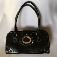 SALE Black Purse/Handbag with Silver Hardware Faux-leather (but looks very real), black handles, silver rivets and details. Zippered top with magnetic closure flap. Interior pockets and zippered pockets. Looks brand new. Got SO many compliments when using this bag! Bags Totes