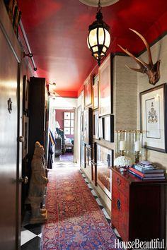 Designer Scot Meacham Wood considers his San Francisco entryway an introduction to the many things he loves: layers of texture and color, books, art, and chinoiserie. Walls in a Phillip Jeffries grass cloth.