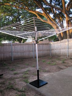 Buy picnic umbrella base to use for existing clothesline since our base in the ground broke! Rad!