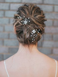 """This sweet freshwater pearl flower wedding bridal hairpin is accented with rhinestones and is on flexible silver wire. The classic design of these wedding hair pins are great for a timeless, romantic look. Looks great with a white, off-white or ivory dress. Measures approximately 2"""" x 2"""" (Not including hair pin.)"""