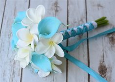 Natural Touch Turquoise Aruba Blue Calla Lilies and Off White Plumerias Bouquet