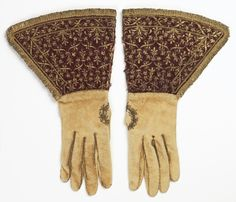 Italy Pair of white leather gloves with deep gauntlets of dark red satin. The gauntlets are embroidered in gold metallic yarns with a small repeating design of a fleur-de-lis, and are edged with gold fringe. Lined with yellow silk. Medieval Clothing, Historical Clothing, Mitten Gloves, Mittens, Vintage Accessories, Fashion Accessories, Elizabethan Dress, Costume Renaissance, Vintage Gloves