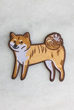 A sweet little shiba, named after our studio pup Aiko (who helps with all your orders, obviously). Based on an illustration by Julia Bereciartu, this embroidered patch has an iron-on backing and measu