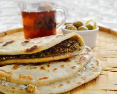 Sawsan Abu Farha combines the classic Lebanese Manousheh with Naan for a comforting Mid Eastern breakfast dish.