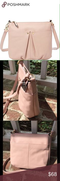 Tignanello genuine leather blush colored purse Tignanello genuine leather blush colored purse. Convertible cross body - can be worn 2 ways.  9 1/2 x 11, top zipper, front snap closure, back slip pocket.  Inside has one zip pocket and 2 slip pockets Tignanello Bags Crossbody Bags