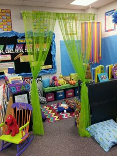 Cute idea to use a hanging curtain rod and curtains to divide classroom into a reading area.Cute idea to use a hanging curtain rod and curtains to divide classroom into a reading area. Classroom Setting, Classroom Design, Future Classroom, Classroom Themes, Kindergarten Classroom Setup, Classroom Libraries, Neon Classroom Decor, Classroom Ceiling Decorations, Year 3 Classroom Ideas