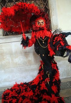 https://flic.kr/p/9NfwLz | Long legged lass in bright red and black (IMG_2816a) | I had the pleasure of attending the Carnevale in Venice in February 2011 - what a great experience! This was about my 4th or 5th Carnevale and they keep getting better. Many of the masked characters recognized me from prior years and gave me great access for photos. I also had the chance to shoot with many others; some in masks and costumes, some face paintees, and some faces in the crowd - great fun. Because…