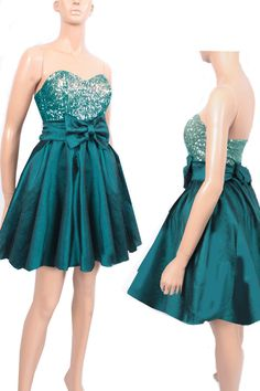Elegant sequins strapless dress covered with dark taffeta skirt and belt with big bow    sequins strapless materials: ,taffeta sequins    * A -