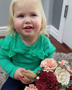 This little cutie loves the Sola (wood) flower bouquet I made... Had to snap some pictures. Stay tuned, we have a HUGE shipment of wood flowers in dozens of varieties arriving within the next few days! (Did you know you can easily dye them any color you want?! Seriously, it's amazing.) #homedecor #woodflowers #solaflowers #flowerarrangement #custombouquet #workwithkids #comingsoon #happyflowers #woodroses