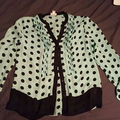 Polka Dot Blouse Mint green polka dot Blouse with ruffled front and black trim. Excellent condition, never worn. Bought about a year ago but my shoulders are too broad. Offers welcome. Worthington Tops Button Down Shirts