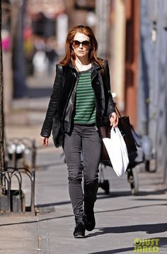 Flame-haired Hollywood actress Julianne Moore is seen walking on a sunny day in the West Village in New York City