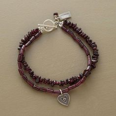 "DOUBLE GARNET BRACELET - Garnets two ways: one strand of chips, another of cylinder beads. The latter dangles a sterling silver heart charm. Toggle clasp. Ours exclusively, handcrafted in USA. Approx. 7-1/2""L."