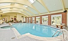 The pool is nearly 40 feet long, with a hot tub on the side and a wood-paneled sauna close by.