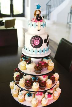 Totally Rad Rockstar Party {Girls Birthday}  – Multi-sized cupcake tower cake with star, microphone and music note fondant toppers
