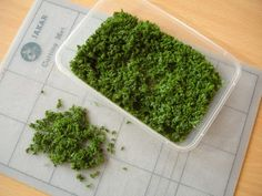 tutorial grass: sheet of reticulated foam (pulling bits out or snipping with scissors), dabbed this with Pva glue, sprinkled on a mixture of poppy seeds and...