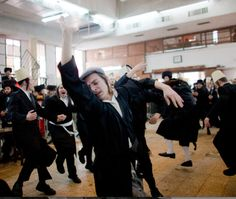 Purim may just be the most fun Jews have in synagogue all year.  This young Hassidic guy busting a move in Mordechai's honor.