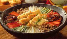 두부전골(dubu-jeongol) / Tofu Hot Pot  A moderately spicy and well-presented hot pot, made with tofu, beef, and vegetables. It is cooked at the table.