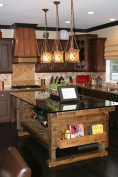 LOVE THE KITCHEN ISLAND , LIGHTING FIXTURES AND THE COPPER HOOD ON TOP OF STOVE.