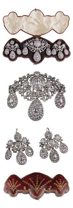 18TH CENTURY PORTUGUESE TOPAZ DEMI PARURE. The set is comprised of a central girandole stomacher pendent, flanked by matching girandole earrings. Each piece is set with both white and the softest pink natural topaz stones, closed set and foil backed in silver. Each stone is set with a foil behind the stone to give a soft light that would have enhanced the jewel in candlelight. The demi parure is housed in its original hand tooled leather case.