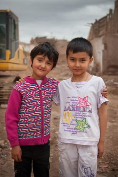 These Uighur girls are standing in the ruins of Kashgar's old town, largely destroyed by earthquake. Redevelopment of the old town will result in safer buildings but there are questions about preservation of Uighur culture in a town full of ancient structures and cultural artefacts.