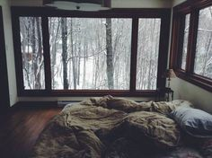 Large bedroom windows to see the snow outside while cuddled up in a warm bed.
