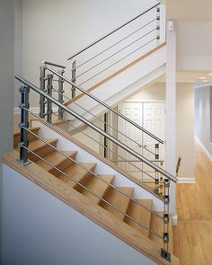 Looking for Staircase Design Inspiration? Check out our photo gallery of Modern Stair Railing Ideas. Stainless Steel Stair Railing, Modern Stair Railing, Stair Railing Design, Stair Handrail, Staircase Railings, Modern Stairs, Railing Ideas, Metal Handrails, Bannister