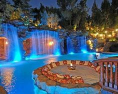 Gorgeous pool with waterfalls off of the rocks and excellent lighting