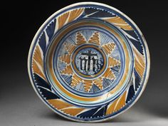Dish of tin-glazed earthenware painted in colours, made in Faenza, ca. 1500