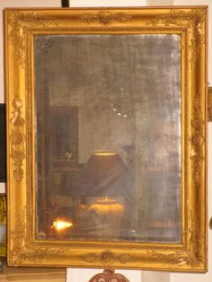 A Restoration Style mirror, dating back to the early 19th century. The original mercury glass features a lovely aged patina. This type of mirror was traditionally displayed in a living room or bedroom of wealthy French families. 76cm high x 59cm wide, 5cm deep frame The restoration period in France was between 1814 to 1830. The Bourbon regime lead France's economic recovery following Napoleon's defeat at Waterloo. It was also a prosperous period for French literature and arts. Pricing…
