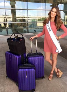 irst, you have to love the all of the purple luggage! Then, look at the gorgeous Alexandra Miller in her travel outfit on the way to Miss USA. The shift dress is in and is here to stay. Although this silhouette does not hug her amazing body, the summer shape shows off her amazing legs! Pairing it with lots of bangles and a matching necklace was a great choice for this outfit because they add just the right amount of travel glamour.