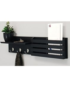 This coat rack shelf features 3 metal hooks, 2 slots for mail and 1 integrated display shelf. It's ideal for entryway organization and perfect for keys, accessories, mail and displaying your favorite small decorative items. This easy to hang shelf comes assembled with hanging hardware.